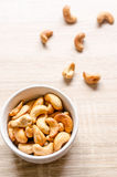 Close up cashew nuts on wooden background Royalty Free Stock Photo