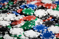 Close up of casino chips background. Gambling, fortune, game and entertainment concept - close up of casino chips background royalty free stock photos
