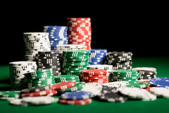 Close up of casino chips on green table surface Stock Images