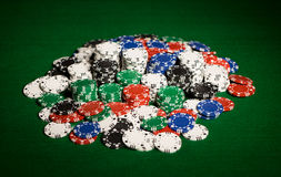 Close up of casino chips on green table surface Royalty Free Stock Photos