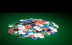 Close up of casino chips on green table surface Royalty Free Stock Photography