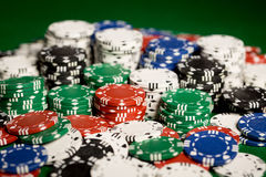 Close up of casino chips on green table surface Royalty Free Stock Photo
