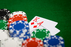 Close up of casino chips and playing cards Royalty Free Stock Image