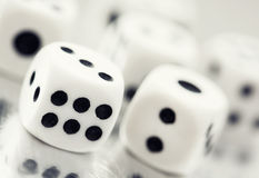 Close up of a casino dice. Casino dices on a reflective table Stock Photography