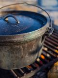Cast Iron Dutch Oven over Campfire stock images