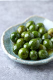 Castelvetrano Olives on a Ceramic Plate Stock Photos