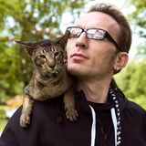 Close up cat and guy portrait outdoor Royalty Free Stock Images