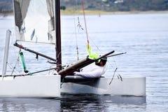 Close up of catamaran and sailor Royalty Free Stock Photo