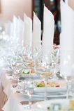 Close-up catering table set. Catering table set service with silverware, napkin and glass at restaurant before party Stock Image