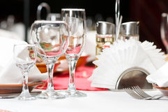 Close-up catering table set. Catering table set service with silverware, napkin and glass at restaurant before party Stock Photography