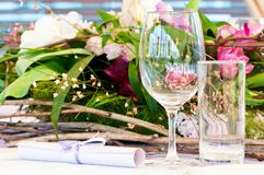 Close-up catering table set. Catering table set service with silverware, fresh flowers and glass at restaurant before party Royalty Free Stock Image