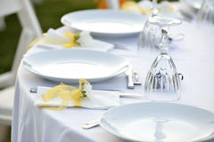 Close-up catering table set. Catering table set service with silverware, napkin and glass at restaurant before party and wedding Royalty Free Stock Images