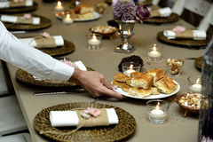 Close-up catering table set. Catering table set service with silverware, napkin and glass at restaurant before party and wedding Stock Image