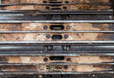 Close up caterpillar tractor fragment and soil background Stock Photos