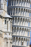 Close-up of cathedral and leaning tower in Pisa. At this picture the restoration of the Leaning Tower of Pisa has just finished. The Torre pendente di Pisa is Royalty Free Stock Photography