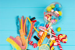 Close up of cattered chewing and licorice sweets, lollipops and Stock Photo