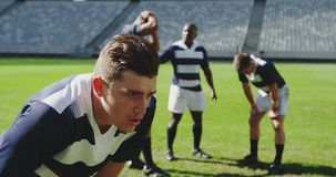 Male rugby player disappointed after losing match in stadium 4k stock footage