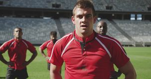 Male rugby player standing with hands on hip in stadium 4k. Close-up of Caucasian male rugby player standing with hands on hip in stadium. He is tired and stock footage