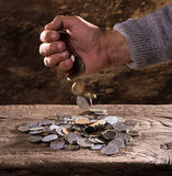 Close up of  caucasian old man's hands  and pile of old coins Stock Photos