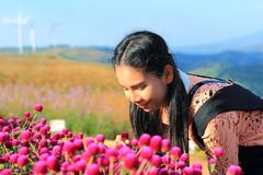 Close up caucasian woman and expression happiness,pretty girl with yellow and pink Gomphrena flowers royalty free stock photography