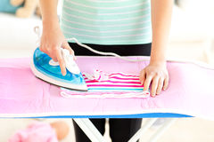 Close-up of a caucasian woman ironing her clothes Royalty Free Stock Photos
