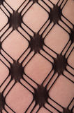 Close up of Caucasian woman in pattern stockings Royalty Free Stock Photography