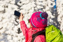 Close up of caucasian young woman in colorful outfit taking a br. Close up of caucasian woman in colorful outfit taking a break from backcountry skiing to take a Stock Image