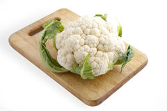 Close-up of cauliflower on cutting board Stock Images