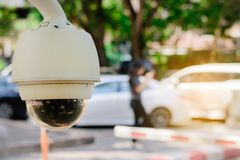 Close-up CCTV monitoring, security cameras at outdoor car parking. stock photos
