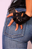 Close up of cell phone in back pocket Stock Photo