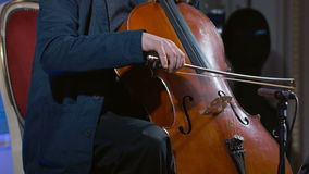 Close-up of a cello player bowing his instrument stock video footage