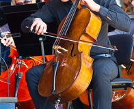 Close-up of cellos being played in a concert Royalty Free Stock Image