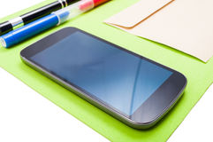 Close up of cellphone on organized workplace Royalty Free Stock Photo