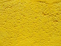 Close up of cement  wall in yellow colored backgrounds royalty free stock image