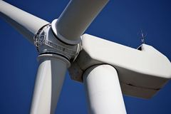Close up of center of wind turbine with blue sky as background.  royalty free stock photo