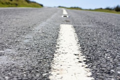 Close up of the centre white line of a road Stock Photography