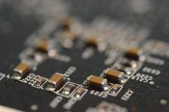 Close up ceramic capacitors on circuit board Stock Photography