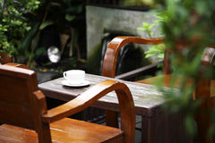 Close up ceramic coffee cup on wooden table Royalty Free Stock Photo