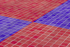 Close-up of ceramic floor made of red and blue glazed tile Stock Image