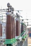Ceramic isolators on power substation. Close up of ceramic isolators on High voltage electricity transformation substation Royalty Free Stock Image