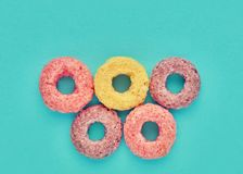 Close up cereal rings on blue background. Concept of nutrition, health, power performance and stamina stock image