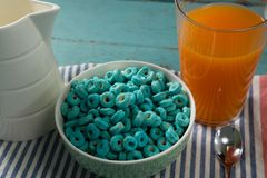 Cereal rings and orange juice on napkin cloth Royalty Free Stock Photo