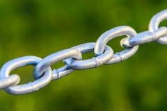 Close up chain do metal esticado na rua Fotos de Stock Royalty Free