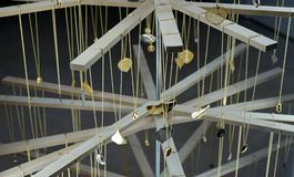 Close-up of chain pendants on wooden rack jewelry holder.  Royalty Free Stock Image