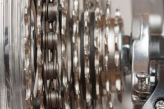 Close up of  chain on  9-speed cassette on rear wheel of bike, s Royalty Free Stock Photos