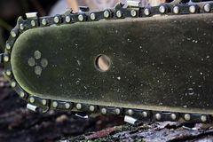 Close up chainsaw teeth. Close up chainsaw and teeth set on a chain around the edge royalty free stock photo
