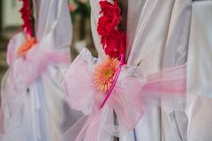 Close up on chair wedding decoration - flower Stock Image