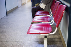 Close up on Chairs for patient and visitor in hospital, defocused people Royalty Free Stock Image