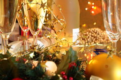 Close-up of champagne,baubles,candle lights. Royalty Free Stock Images