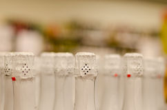 Close up of champagne bottleneck with white paper Royalty Free Stock Images